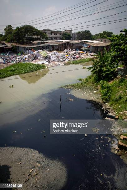 Black water probably dye enters the river from a factory, environmental pollution on the river banks surrounding some of the textile industry...