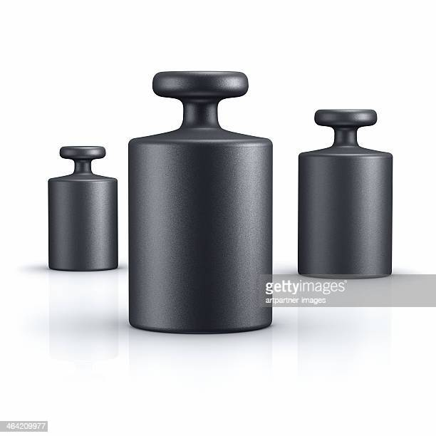 black weights of different size on white - mass unit of measurement stock pictures, royalty-free photos & images