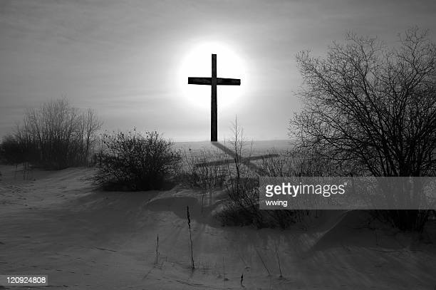 black & white cross and shadow - death and resurrection of jesus stock photos and pictures