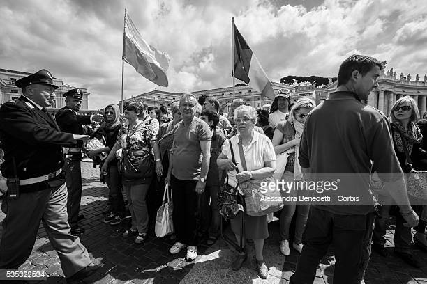 Pilgrims gather in St Peter's Square one day before the historical canonzation of Jonh Paul II and John XXIIIThe double canonisation of two of...