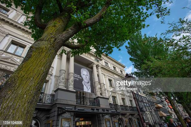 Black & White portrait of the late journalist Peter R. De Vries seen on the facade of the Royal Theatre Carrë. The Royal Theatre Carrë opened its...