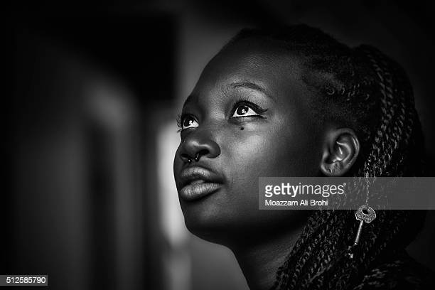 black & white portrait of young black woman looking up - black and white stock pictures, royalty-free photos & images