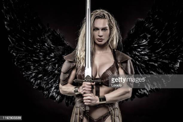 black wing viking valkyrie female - traditional armor stock pictures, royalty-free photos & images