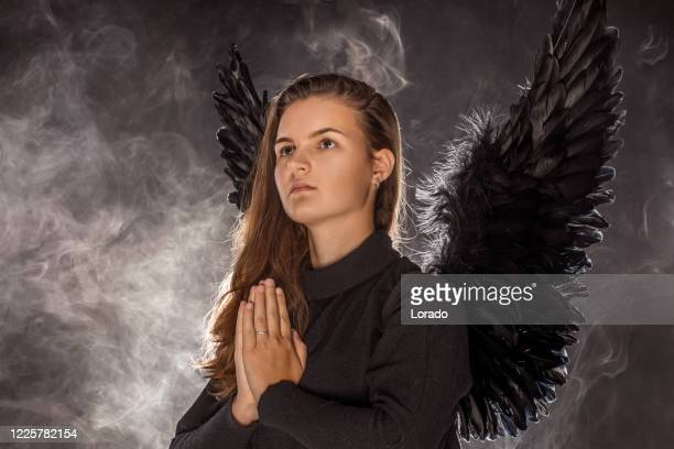 black winged female angel - gunman stock pictures, royalty-free photos & images