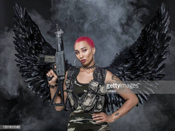 black winged female warrior military angel - gunman stock pictures, royalty-free photos & images
