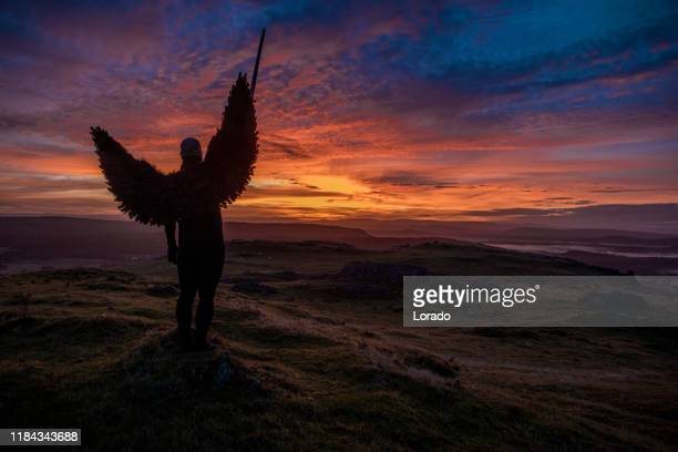 black winged warrior angel at dawn - warrior person stock pictures, royalty-free photos & images