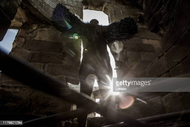 black winged warrior angel in an abandoned castle - golf tournament stock pictures, royalty-free photos & images