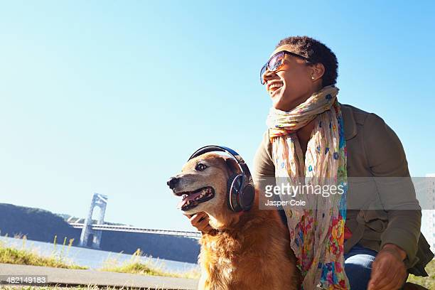 Black woman and dog relaxing in park
