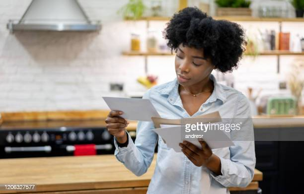 black woman at home checking the mail - message stock pictures, royalty-free photos & images