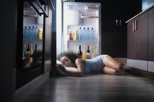 Black Woman Awake For Heat Wave Sleeping in Fridge 980932010