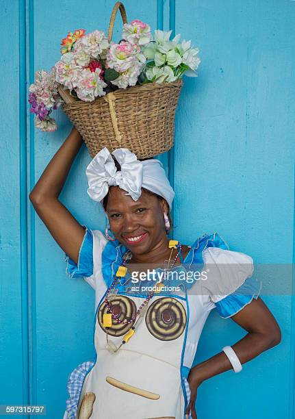 Black woman balancing basket on her head