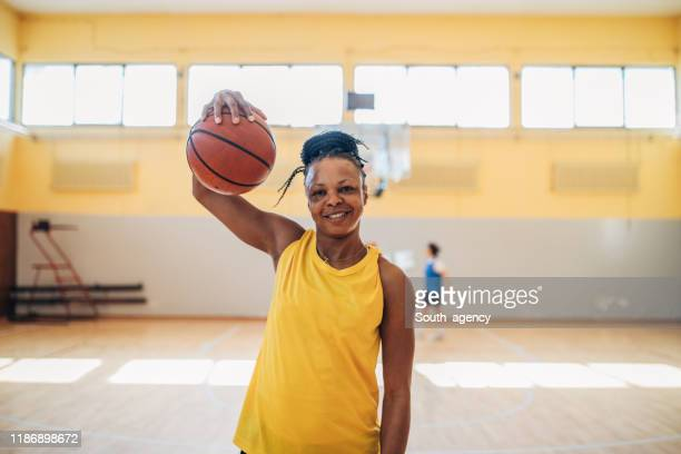 black woman basketball player - professional sportsperson stock pictures, royalty-free photos & images