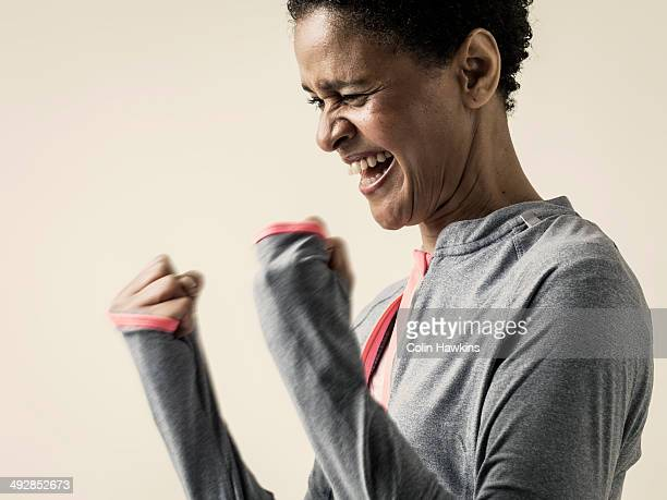 Black woman celebrating in exercise top