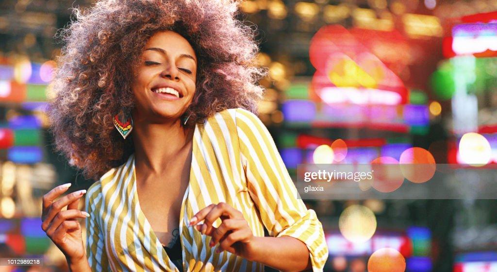 Black woman dancing at a concert. : Stock Photo