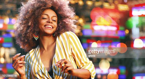 black woman dancing at a concert. - music festival stock pictures, royalty-free photos & images