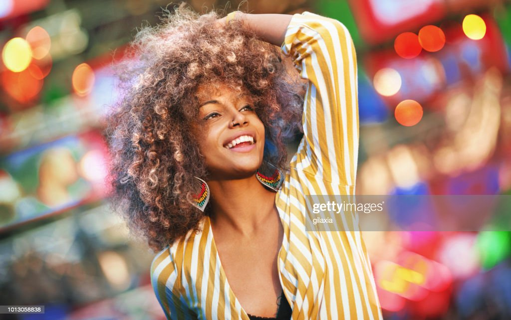 Black woman dancing at a concert. : Stock Photo