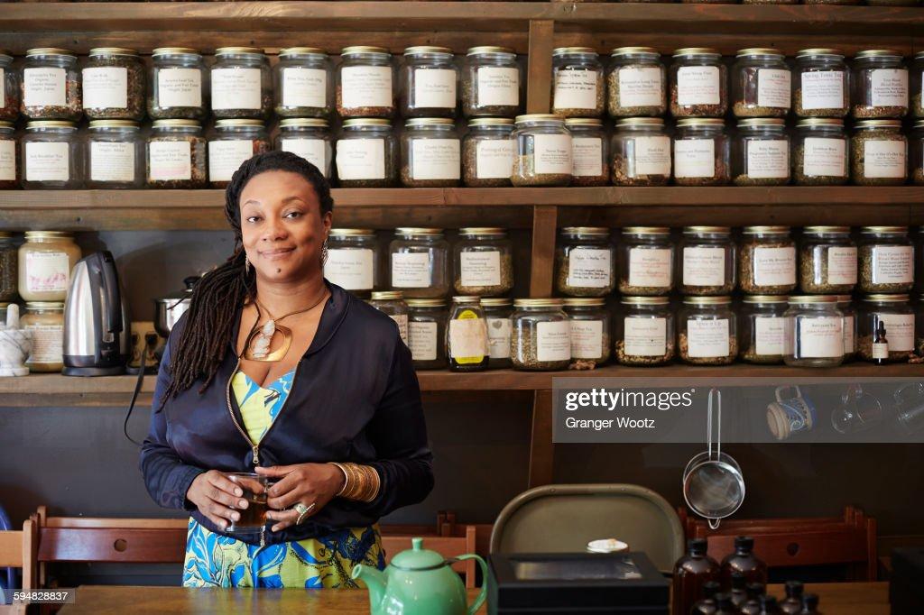 Black woman drinking tea in tea shop : Stock Photo