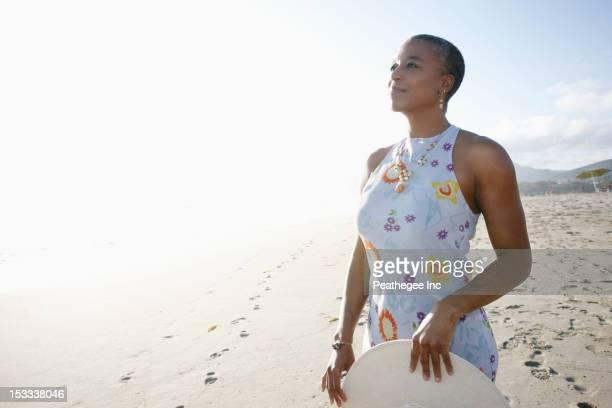 black woman enjoying the beach - サンドレス ストックフォトと画像