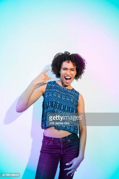 Black woman gesturing with fingers