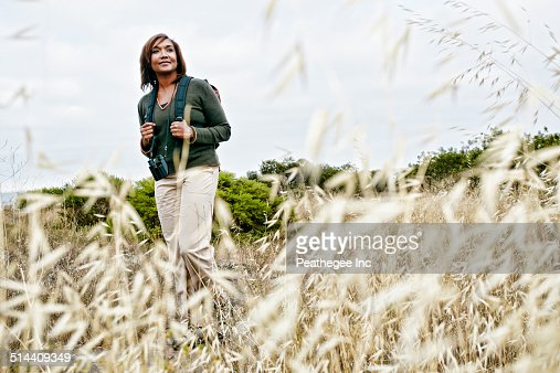 Black Woman Hiking On Rural Path Stock Photo