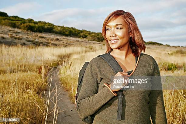 Black Woman Hiking On Rural Path