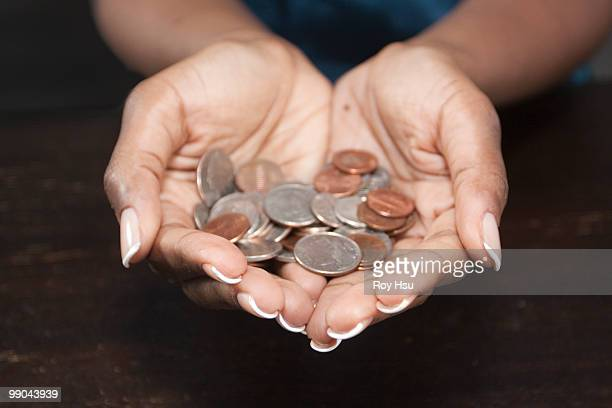 Black woman holding coins