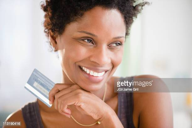 Black woman holding credit card