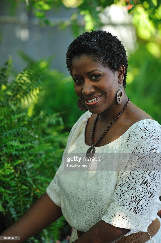 Black woman in a garden : Stock Photo