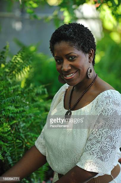 black woman in a garden - images of fat black women stock photos and pictures