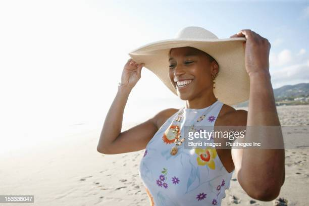 black woman in hat enjoying the beach - one mature woman only stock pictures, royalty-free photos & images