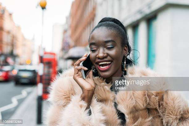 black woman in london, uk, using smartphone - ecstatic stock pictures, royalty-free photos & images