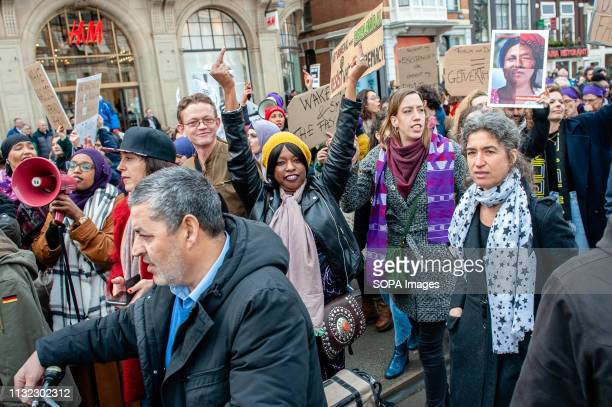 A black woman is seen showing middle fingers to the far right group during the demonstration Thousands of people gathered at the Dam square in the...