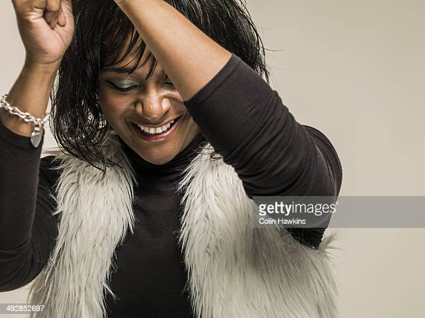 black woman laughing - colin hawkins stock pictures, royalty-free photos & images
