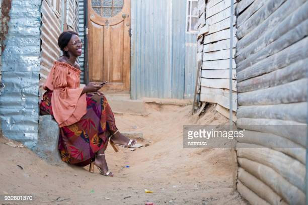 black woman laughing - black alley stock photos and pictures
