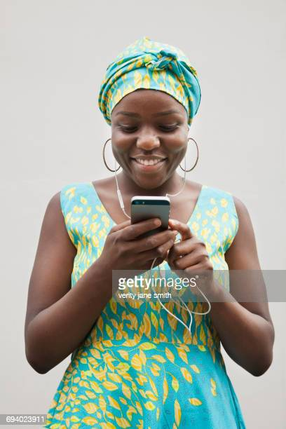 Black woman listening to music on cell phone