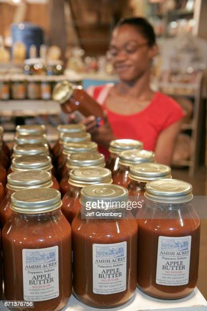 A black woman looking at apple butter in Amish Acres Historic Farm gift store