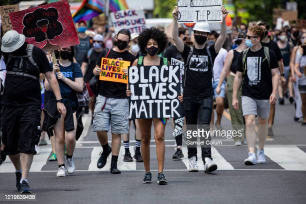 Black woman marches at the head of the group of members and allies of the LGBTQ community to the White House as part of the Pride and Black Lives...