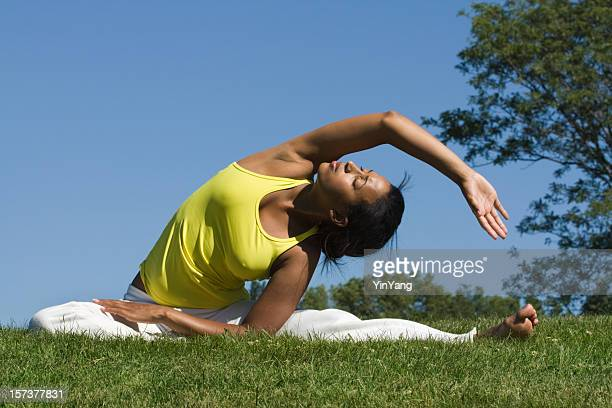 Black Woman of African Descent Practicing Yoga Exercises, Stretching Outdoors