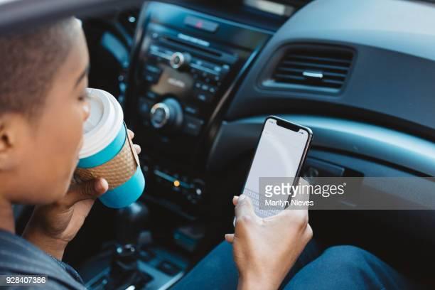 black woman on the phone using rideshare