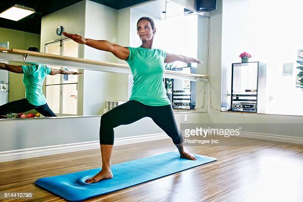 Black woman practicing yoga in studio