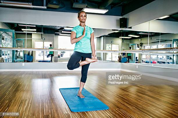 Black woman practicing yoga in studio