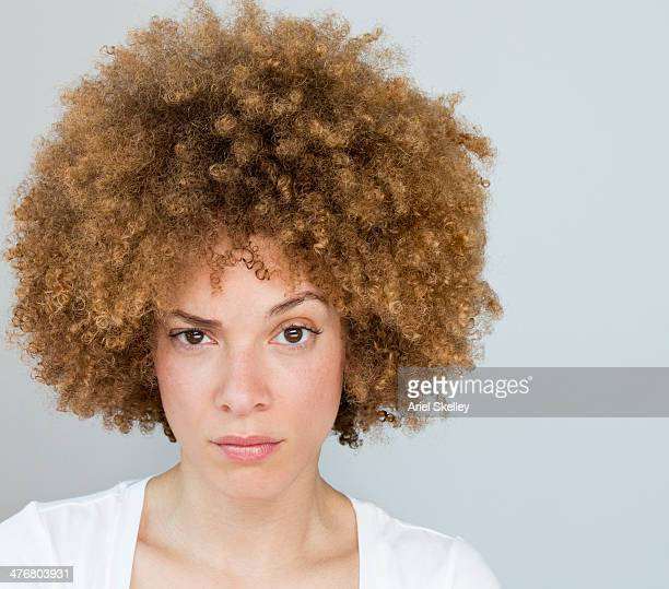 black woman raising her eyebrow - uncertainty stock pictures, royalty-free photos & images