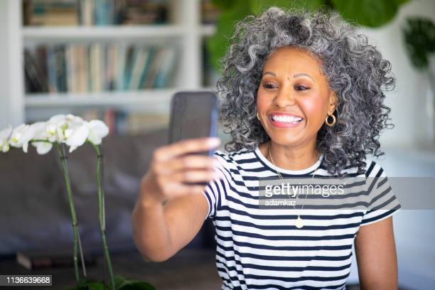 Black Woman Recording a Video Message on her Smartphone