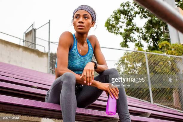 black woman resting on bleachers - オリンピック選手 ストックフォトと画像