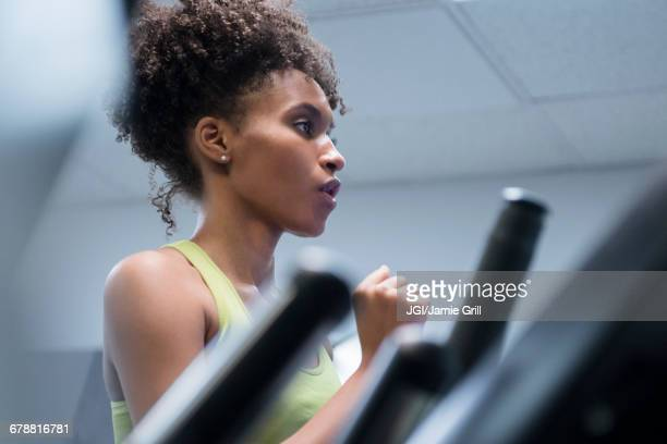 Black woman running on treadmill