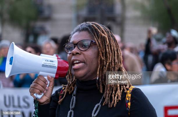 A black woman seen speaking on a megaphone during the demonstration A new manifestation against institutional racism has crossed the streets of the...