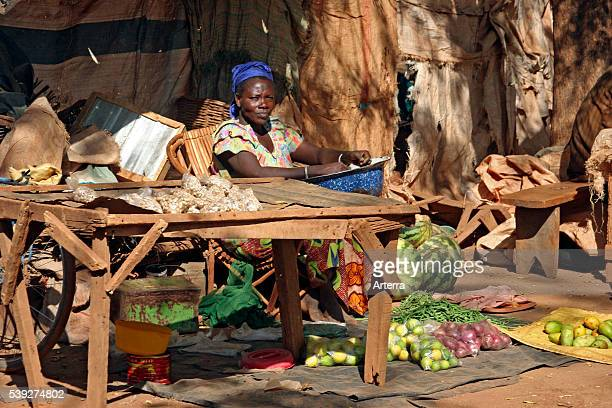 Black woman selling fruit and vegetables at market stall in Kongoussi Burkina Faso West Africa