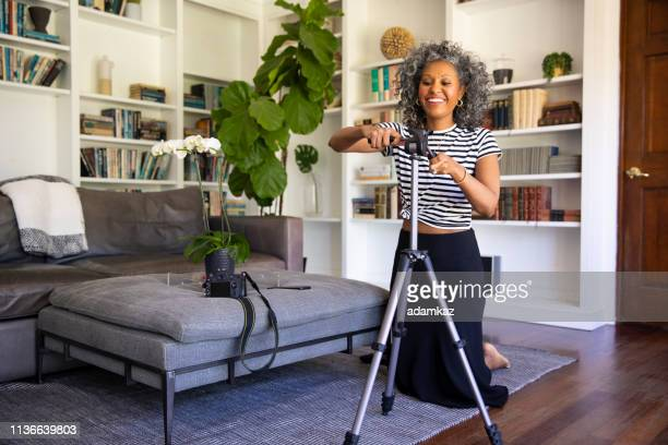 Black Woman Setting up Tripod and Camera to Record Vlog