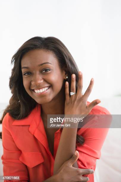 black woman showing off engagement ring - black women engagement rings stock pictures, royalty-free photos & images