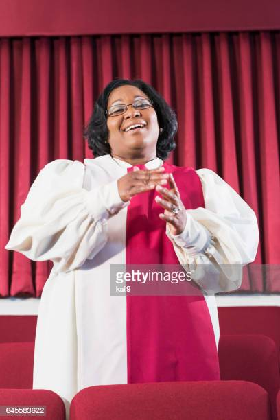 black woman singing in church choir - gospel stock photos and pictures